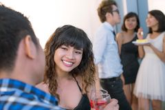 Flirty girl. Teenage girl talking with a boy at party Stock Photos