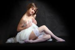 Flirty girl dressed in bridal veil Stock Images