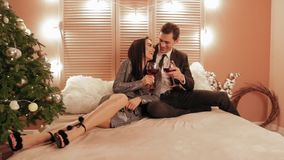 Flirty and nice attitude between brunet male abd female at the hotel drinking red wine during new year holyday slow. Flirty and nice attitude between brunet male stock video