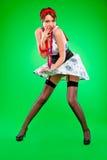 Flirty przyglądająca dziewczyny mienia suknia dmuchająca - dmuchać wiatrem Obraz Stock
