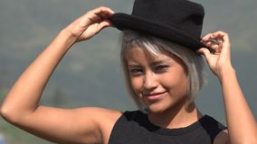 Flirty And Attractive Woman With Hat. A young Latina female adult royalty free stock images