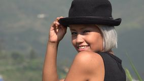 Flirty And Attractive Young Woman With Hat. A young Latina female adult stock images