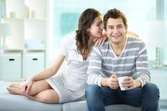 Flirty whisper Stock Images