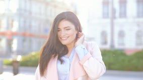 Flirty woman city walk smiling playful female hair stock video footage