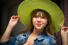 Flirty woman in green hat Royalty Free Stock Photo