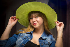 Flirty woman in green hat Royalty Free Stock Photography