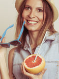 Flirty woman in hat hold sunglasses and grapefruit Stock Photography