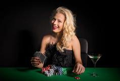 Flirty woman playing poker royalty free stock photos