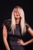 Flirty woman in posing Stock Photography