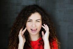 Flirty young woman winking licking lips teasing stock image