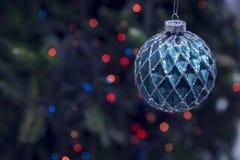 Flitter des neuen Jahres gegen dunklen Hintergrund Lizenzfreies Stockbild