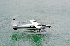 Float Airplane on Water. A float plane landing on water stock photography