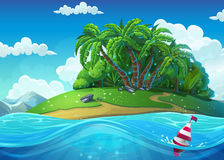 Float on the background of the island with palm trees in the sea. Under clouds. Marine life landscape - the ocean and the underwater Royalty Free Stock Image