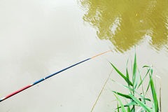 Float floating on surface of river while fishing Stock Photos