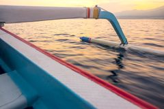 Float of the Indonesian Trimaran in the Morning Sea. Indonesia. Sea dawn. Traditional Indonesian boat and outrigger royalty free stock image