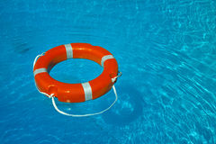 Float lifesaver. On blue water Stock Images