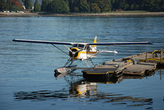 Float plane. Small float plane sitting at a dock in Canada Stock Image