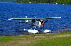 Float plane. On beach on Lake Pleasant, NY stock photos