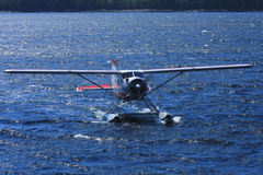 Float plane in blue ocean water Stock Images