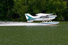 Float plane. Floatplane is landing on water Royalty Free Stock Photo