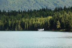 Float plane on glacial lake in Alaska in summer Stock Image