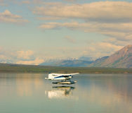 A float-plane landing in atlin's scenic harbor Stock Photo