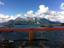 Float Plane. With a mountain back drop Royalty Free Stock Image