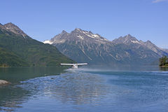 Float Plane Taking off From a Remote Lake Stock Image