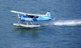 Float plane, taking off from water Royalty Free Stock Image