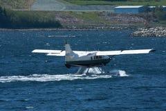 Float plane in water in Alaska. Float plane returning to the dock in Ketchikan, Alaska Royalty Free Stock Photos