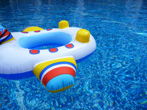 Float on a pool. A plane shaped children float in a swimming pool Royalty Free Stock Images