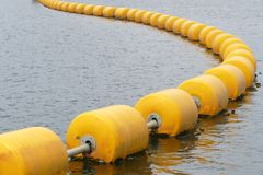 Yellow floating body for demarcation Stock Image