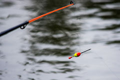 Float on the water with a fishing line Stock Photo