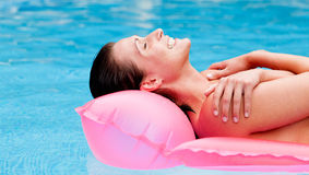 Float water woman. Relaxed woman floating on lilo over blue sea water tanning body Royalty Free Stock Photo