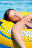 Float woman. Lilo mattress carefree resting woman floating on blue water in vacation freetime Royalty Free Stock Photo