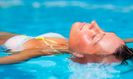 Float woman. Water sea ocean relaxing girl in holiday Royalty Free Stock Photography