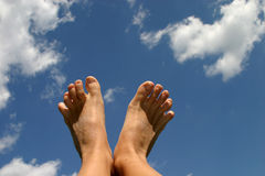 Floating. Feet in the sky Royalty Free Stock Image