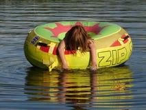 Floating. Child floating in tube on lake Royalty Free Stock Images