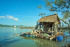 Floating accommodation of local fishermen in the sea. Stock Photo