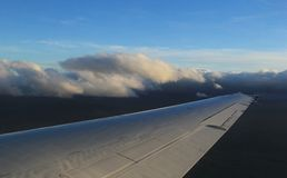 Floating Aeroplane wing above the Clouds Royalty Free Stock Images