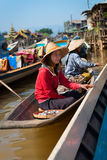 Floating asian vendors on long wooden boat Stock Image