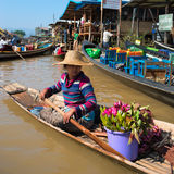 Floating asian vendors on long wooden boat Royalty Free Stock Photo