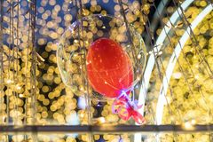 Floating Balloon with abstract yellow bokeh. Red floating Balloon with Blur colorful abstract yellow light bulb bokeh background. 2018 New year and Valentines Stock Photography