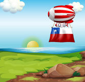 A floating balloon travelling with flag of Chile Royalty Free Stock Images
