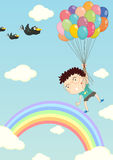 Floating with balloons Royalty Free Stock Images