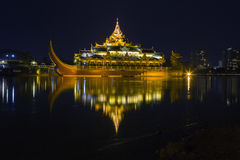 Floating Barge Karaweik Hall on Kandawgyi lake at twilight Stock Photography