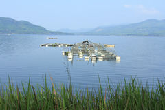 Floating basket. Scenery of a floating basket for keeping live fish in water at a dam of Thailand Stock Images