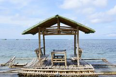 Floating beach bamboo and palm cottage parasol on white sand coast Royalty Free Stock Photos