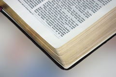 Floating Bible. Close up of corner of Bible blurred background gives illusionof floating royalty free stock photo