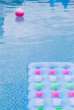 Floating blue and pink air mattress Royalty Free Stock Photo